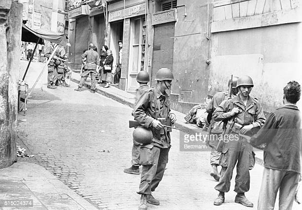 French make housetohouse search in Casbah Algiers Algeria French soldiers in full battle dress are shown during a housetohouse search in the Casbah...