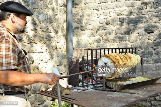French man spit-roasting traditional cake