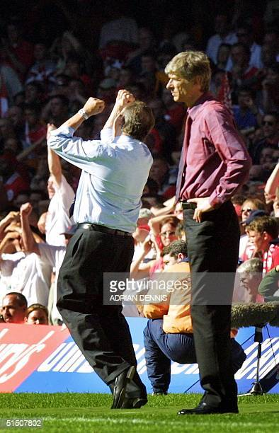 French manager of Liverpool GTrard Houllier reacts to the final whistle while his compatriot Arsene Wenger of Arsenal looks on after the FA Cup final...