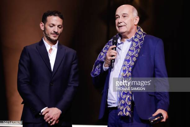 French managing director Michel Duval celebrates with French humorist and host Vincent Dedienne after receiving the 'Music publishing' award during...