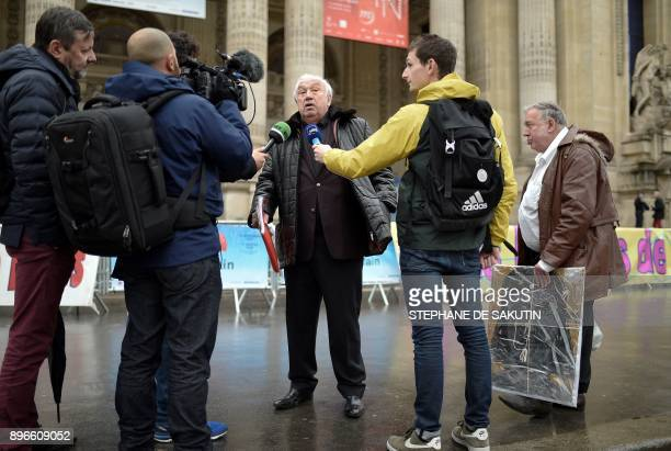 French Marcel Campion who owns the capital's Big Wheel answers journalists during a protest against the cancellation of 'Jours de fetes' funfair...