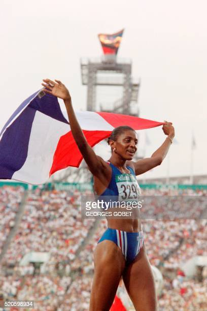 French MarieJose Perec celebrates her victory in the women's Olympic 400m competition at the Olympic Stadium in Atlanta Georgia on July 29 1996 The...