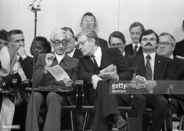 French marine explorer, Jacques-Yves Cousteau, and West German Chancellor Helmut Schmidt discuss the day's program at Harvard University's 328th...
