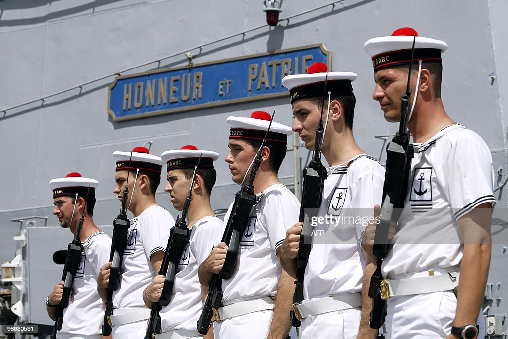 French marine honor guards stand on March 22, 2010, on the deck of French helicopter-carrier Jeanne d'Arc, as it leaves Fort-de-France on the French island of La Martinique to Puerto Rico. The Jeanne d'Arc, built from 1959 to 1961, a 182-meter-long Naval Academy ship, carrying a crew of 585 officers and sailors, is on its last trip as a training vessel. AFP PHOTO