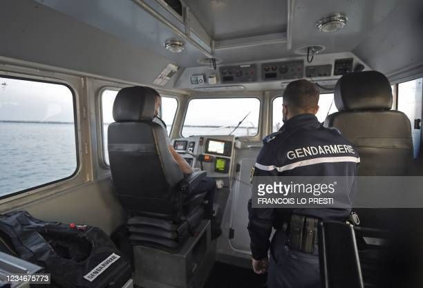 French Maritime Gendarmes from Boulogne-Sur-Mer, south of the port of Calais, search for migrants at sea trying to cross the Channel on August 12,...