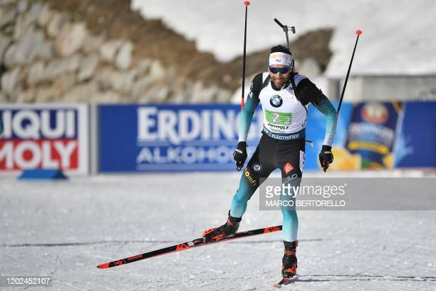 French Martin Fourcade competes in the Men 4x75 km Relay Competition at the IBU Biathlon World Cup in RasenAntholz Italian Alps on February 22 2020