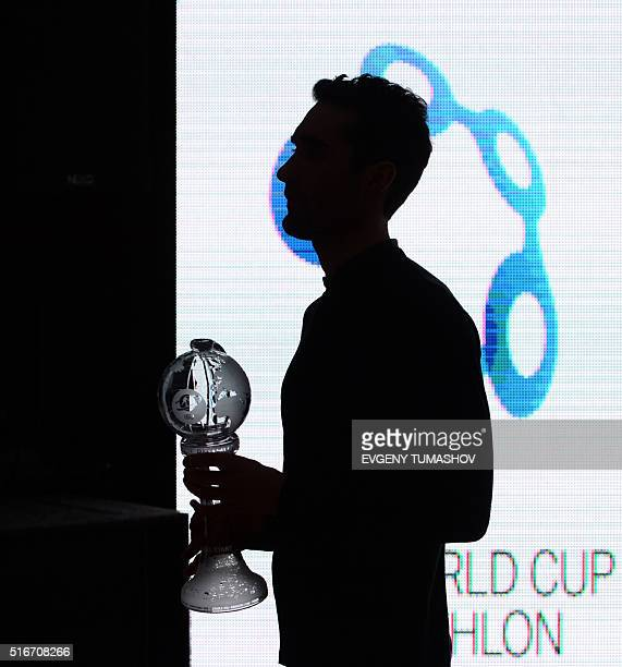 French Martin Fourcade holds his Big Crystal Globe in the overall ranking at the 201516 Biathlon World Cup in KhantyMansiysk on March 20 2016 / AFP /...