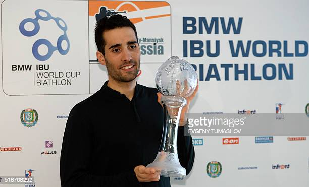French Martin Fourcade poses with his Big Crystal Globe in the overall ranking at the 201516 Biathlon World Cup in KhantyMansiysk on March 20 2016 /...