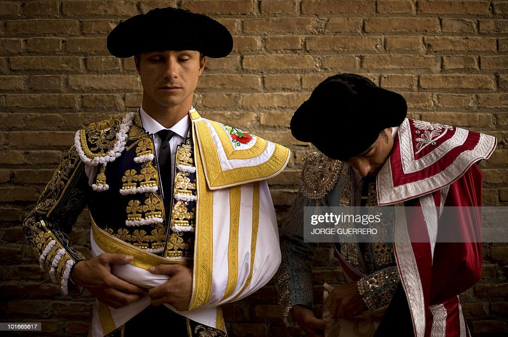 French matador Juan Bautista (L) concentrates prior to a corrida at the Granada bullring on June 6, 2010 in Granada, southern Spain.