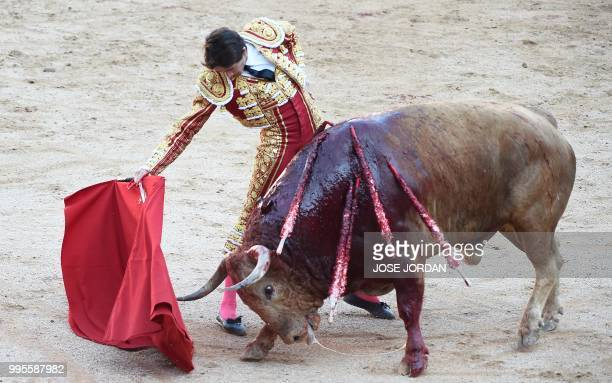 French matador Sebastian Castella performs a pass on a Fuente Ymbro fighting bull during a bullfight of the San Fermin festival in Pamplona northern...