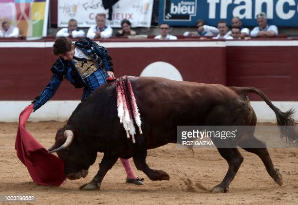 French matador Sebastian Castella performs a pass on a Nunez Del Cuvillo bull at Plumacon arena in Mont de Marsan during the festival of La Madeleine...