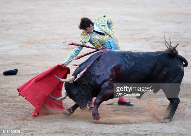 French matador Sebastian Castella performs a pass on a Victoriano del Rio Cortes' fighting bull during the sixth bullfight of the San Fermin Festival...