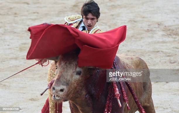 French matador Sebastian Castella performs a pass on aFuente Ymbro fighting bull during a bullfight of the San Fermin festival in Pamplona northern...