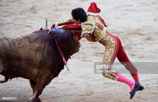 French matador Sebastian Castella stabs a Fuente Ymbro fighting bull during a bullfight of the San Fermin festival in Pamplona northern Spain on July...