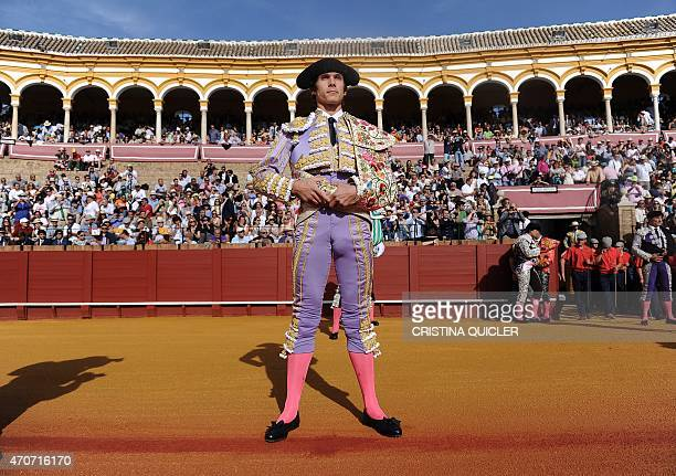 French matador Sebastian Castella stands up as he takes part in the 'paseillo' before a bullfight at the Maestranza bullring in Sevilla on April 22...