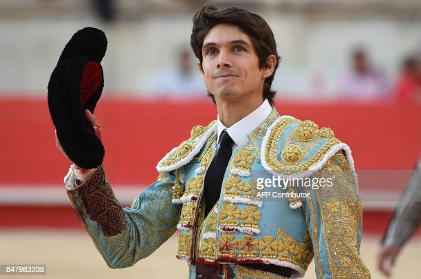 French matador Sebastien Castella celebrates at the end of a bullfight on September 16 2017 during the Nimes Vendages Feria in Nimes southern France...