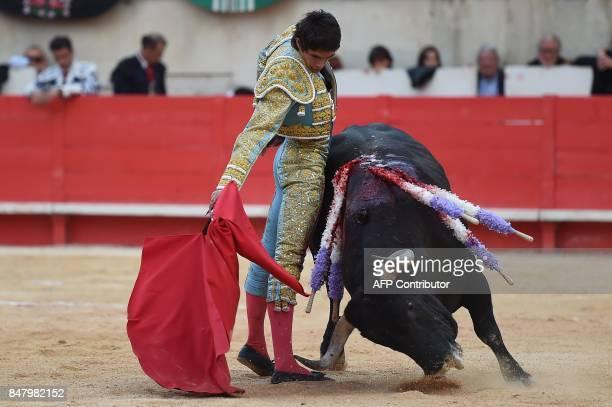 French matador Sebastien Castella makes a muleta pass on a Victoriano Del Rio fighting bull on September 16 2017 during the Nimes Vendages Feria in...