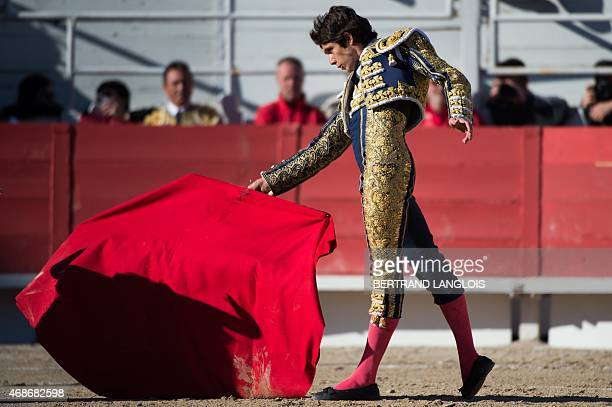 French matador Sebastien Castella performs a pass on a Montalvo bull during the Easter feria on April 5 2015 in Arles southern France AFP PHOTO /...