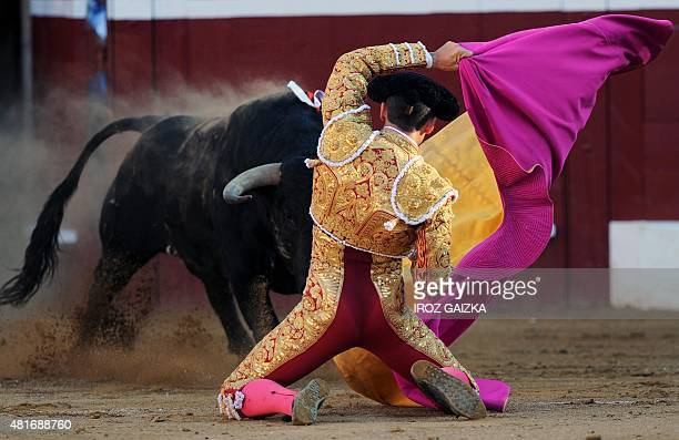 French matador Thomas Dufau performs a pass on a Juan Pedro Domecq bull during the festival of La Madeleine at Plumacon arena in Mont de Marsan...