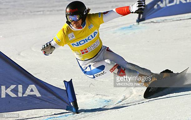 French Mathieu Bozzetto competes in the Men's parallel giant slalom snowboard World Cup race in Limone Piemonte 08 December 2007 Austrian Manuel...