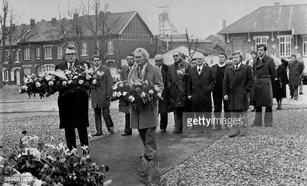 French mayor of Lievin Henri Darras and French mayor of Lille Pierre Mauroy lay down wreath of flowers on December 27 1975 in Lievin in tribute to...