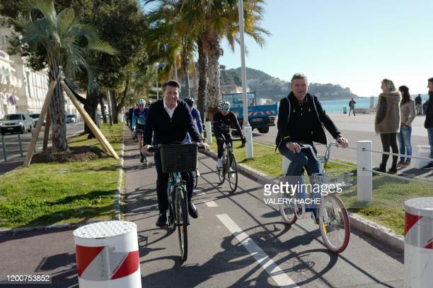 French mayor of Nice Christian Estrosi and former French cyclist Bernard Thevenet on a bikesharing system velobleu's bike ride on a new cycle path in...