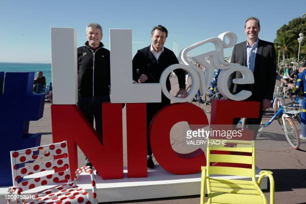 French mayor of Nice Christian Estrosi former French cyclist Bernard Thevenet and Tour de France Director Christian Prudhomme pose on the Promenade...