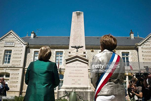 French mayor of the eastern town of Chassagne-Montrachet, Francoise Moreau and Chilean president Michelle Bachelet stand in front of a war memorial...