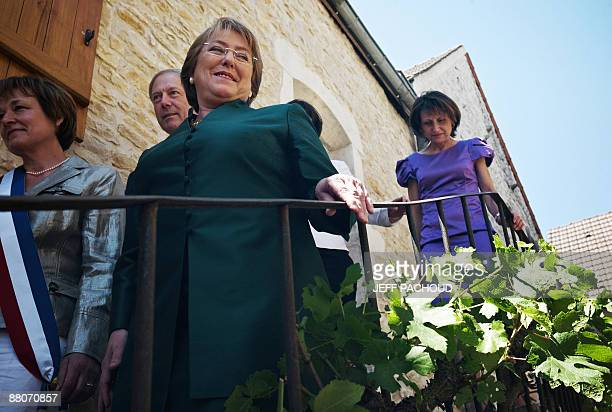 French mayor of the eastern town of Chassagne-Montrachet, Francoise Moreau and Chilean president Michelle Bachelet leave the house of Bachelet's...
