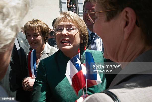 French mayor of the eastern town of Chassagne-Montrachet, Francoise Moreau and Chilean president Michelle Bachelet visit on May 30, 2009...