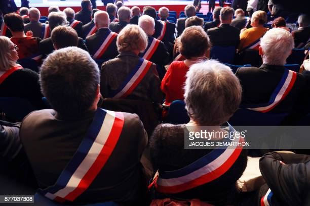 French mayors attend the 100th French Mayors congress on November 21, 2017 in Paris. / AFP PHOTO / JACQUES DEMARTHON
