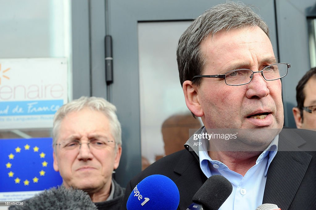 French meat supplier Spanghero's president, Barthelemy Aguerre (R), answers journalists questions on February 11, 2013 at the headquarters of Spanghero in Castelnaudary, southern France. The Europe-wide scandal over horsemeat sold as beef spread on February 10 as leading French retailers pulled products from their shelves and threats of legal action flew. The suspect lasagne meals sold by Swedish frozen food giant Findus in Britain were made by French company Comigel using meat supplied by French meat-processing firm Spanghero. Aguerre declared that Spanghero respected the law.
