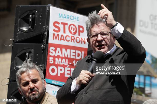 French member of Parliament and leader of the far left La France Insoumise party JeanLuc Melenchon flanked by LFI MP Alexis Corbiere gestures as he...