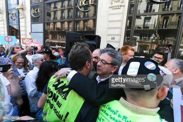 French member of Parliament and leader of the far left La France Insoumise party JeanLuc Melenchon speaks with demonstrators during a protest dubbed...