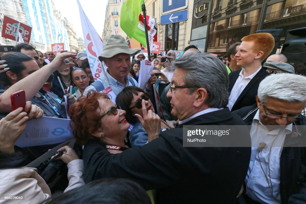 "French member of Parliament and leader of the far left La France Insoumise (LFI) party Jean-Luc Melenchon (C) speaks with demonstrators during a protest dubbed a ""Party for Macron"" (Fete a Macron) against the policies of the French President on the first anniversary of his election, on May 5, 2018, in Paris."