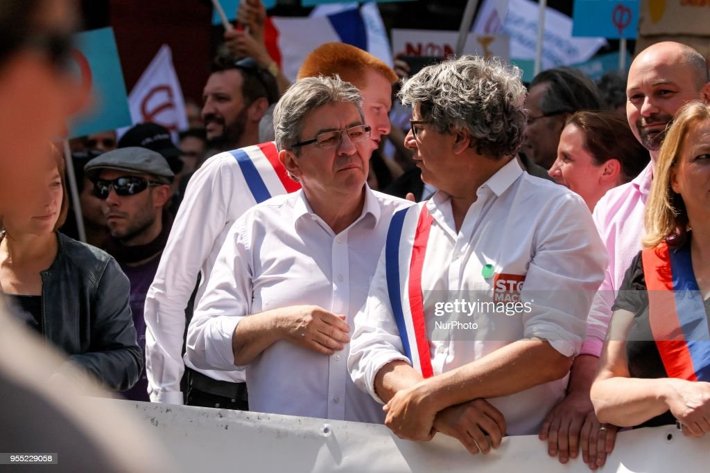 "French member of Parliament and leader of the far left La France Insoumise (LFI) party Jean-Luc Melenchon (C), flanked by LFI MPs Eric Coquerel (R) and Adrien Quatennens (L), walks during a protest dubbed a ""Party for Macron"" (Fete a Macron) against the policies of the French president on the first anniversary of his election, on May 5, 2018, in Paris."
