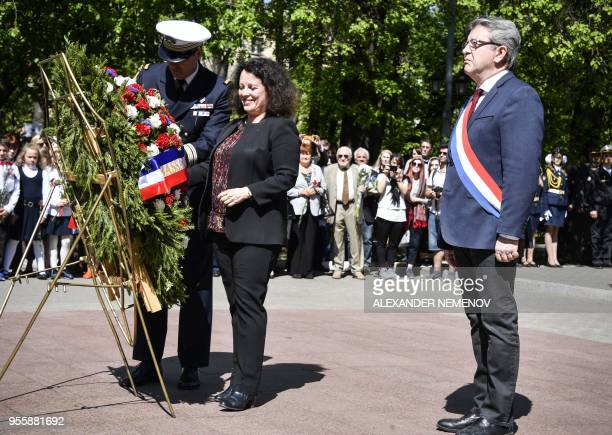 TOPSHOT French member of Parliament and leader of the farleft La France Insoumise party JeanLuc Melenchon and France's ambassador to Russia Sylvie...