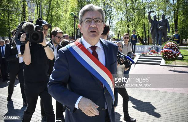 TOPSHOT French member of Parliament and leader of the farleft La France Insoumise party JeanLuc Melenchon visits a monument to France's WWII...
