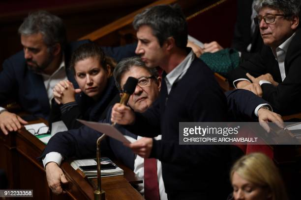 French Member of Parliament and leader of the French leftist party La France Insoumise JeanLuc Melenchon looks at LFI member of Parliament Francois...