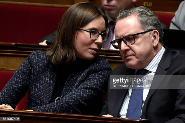 French member of Parliament and president of the La Republique En Marche parliamentary group Richard Ferrand listens to French member of Parliament...