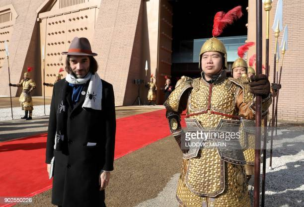 French member of parliament Cedric Villani poses at the entrance of Daminggong Palace in Xian on January 8 2018 French President Emmanuel Macron...