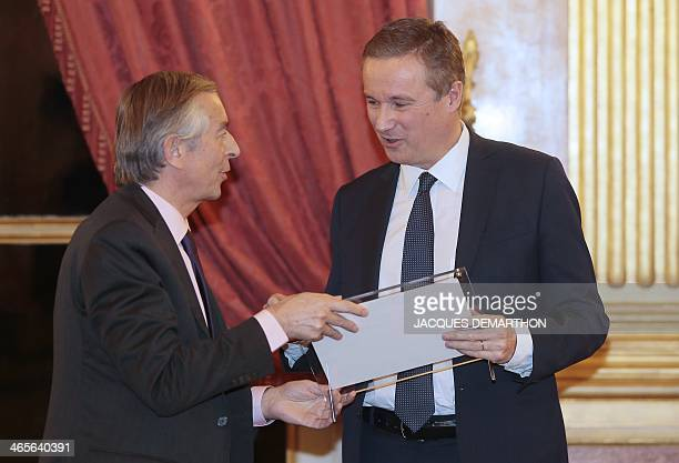 French member of parliament Nicolas DupontAignan receives an award for French member of parliament from the hands of French journalist and member of...