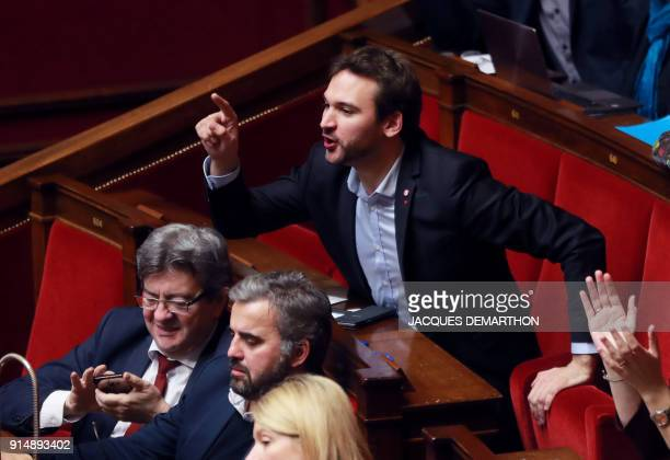 French Member of Parliament of the leftist La France Insousime party Ugo Bernalicis gestures flanked by LFI leader JeanLuc Melenchon and LFI member...