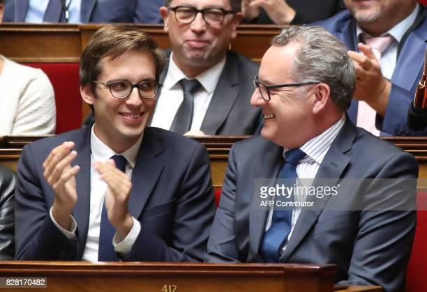 French Member of Parliament Pacôme Rupin applauds as Richard Ferrand looks on at The National Assembly in Paris on August 9 2017 The French...