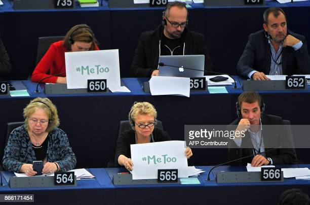 French member of the European Parliament Eva Joly holds a placard reading 'Me too' during a debate about sexual harassment and abuse during the third...