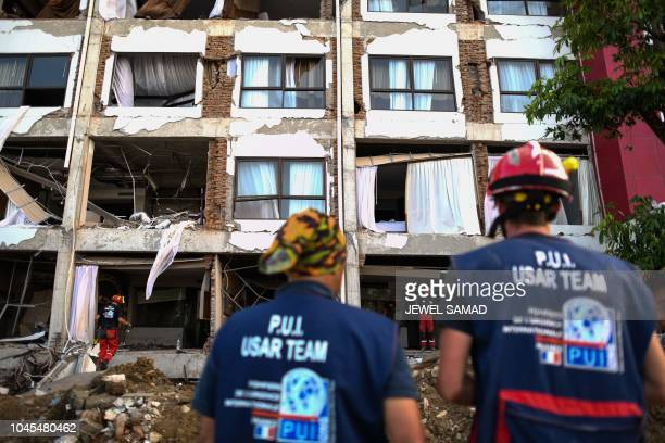 French member of the International Emergency Firefighters search for survivors in the badly damaged Mercure hotel in Palu in Indonesia's Central...