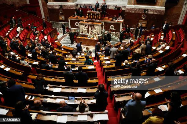 French Members of Parliament gather at the end of a session in The National Assembly in Paris on August 9 2017 The French parliament is voting on an...