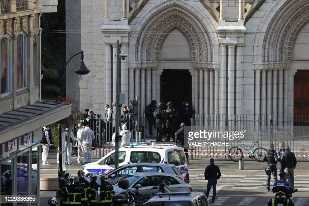 French members of the elite tactical police unit RAID enter to search the Basilica of Notre-Dame de Nice after a knife attack in Nice on October 29,...
