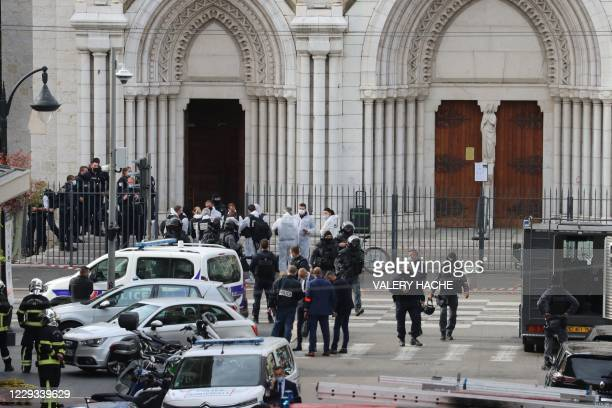 French members of the elite tactical police unit RAID leave after searching the Basilica of Notre-Dame de Nice after a knife attack in Nice on...