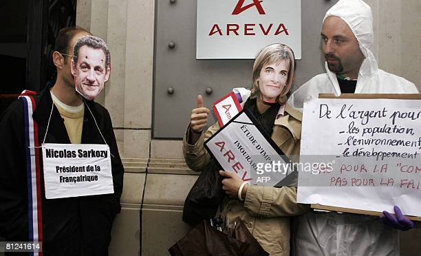 French members of the group 'Areva ne fera pas la loi au Niger' demonstrate on May 27 2008 in front of French nuclear group Areva's headquarters in...